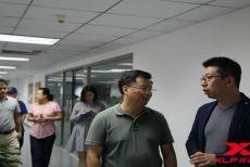 新华社体育部副主任周杰一行来访昆仑决